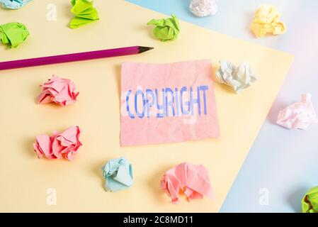 Conceptual hand writing showing Copyright. Concept meaning exclusive legal right to reproduce, publish, sell, or distribute Colored crumpled papers em