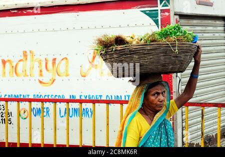 A Mahrati woman walking to the local market. - Stock Photo