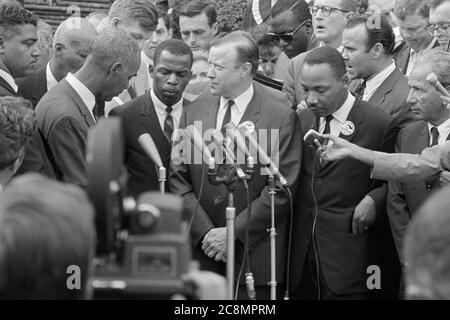 Civil rights leaders, including Martin Luther King (SCLC), John Lewis (SNCC), and Roy Wilkins (NAACP), meeting with reporters following a meeting with President John F. Kennedy after the March on Washington, D.C., August 28, 1963. - Stock Photo