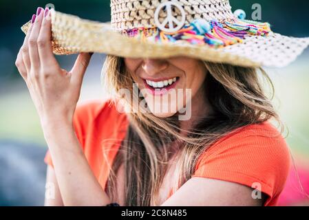 Smile and perfect teeth beautiful young woman laughing and enjoying outdoor - trendy hat and fashion caucasian female portrait - happiness and joyful - Stock Photo