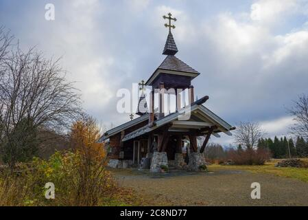 Wooden orthodox chapel on a cloudy October day. Honkavaara Farm in the vicinity of Joensuu, Finland