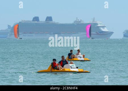 Weymouth, Dorset, UK.  26th July 2020.  UK Weather.   Holidaymakers on pedalos enjoying themselves on the water at the seaside resort of Weymouth in Dorset on a morning of warm hazy sunshine.  Picture Credit: Graham Hunt/Alamy Live News - Stock Photo