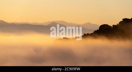 Early morning cloud top panorama view towards the San Gabriel Mountains from Rocky Peak Park between Los Angeles and Ventura Counties in Southern Cali