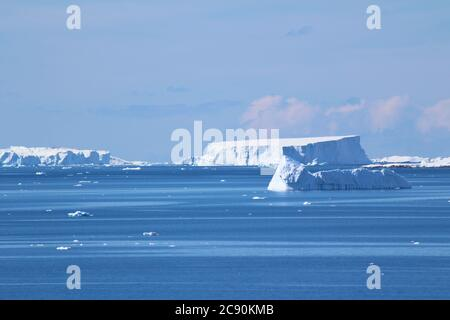 Groups of icebergs floating in the cold waters of the Antarctic peninsula, Antarctica - Stock Photo