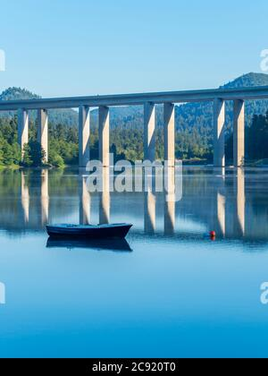 Lonesome boat on lake Bajer in Fuzine Croatia Europe - Stock Photo