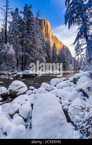 El Capitan above the Merced River in winter, Yosemite National Park, California USA - Stock Photo
