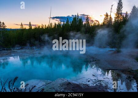 Reflections in the sunset light at a thermal pool at Norris Geyser Basin, Yellowstone National Park