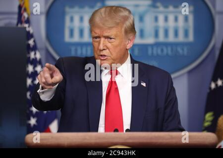 Washington, USA. 28th July, 2020. President Donald Trump holds a press briefing in the Brady Press Briefing Room of the White House on July 28, 2020 in Washington, DC.(Photo by Oliver Contreras/SIPA USA) Credit: Sipa USA/Alamy Live News - Stock Photo