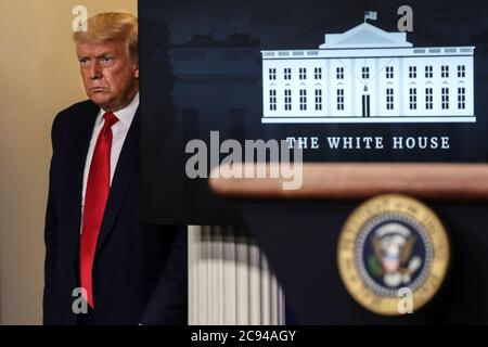 Washington, DC. 28th July, 2020. President Donald Trump arrives to speak during a press briefing in the Brady Press Briefing Room of the White House on July 28, 2020 in Washington, DC.(Photo by Oliver Contreras/SIPA USA)   usage worldwide Credit: dpa/Alamy Live News - Stock Photo