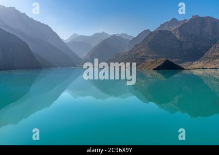 The scenic view of Iskanderkul lake and Fann mountains in Tajikistan - Stock Photo
