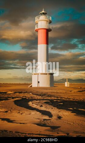 A vertical scenic view of the lighthouse from Parc Natural del Delta de l'Ebre in Riumar, Spain - Stock Photo