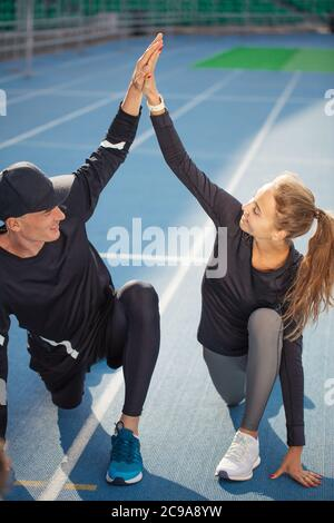 united couple with joined hands are ready to take part in the marathon. full length photo - Stock Photo
