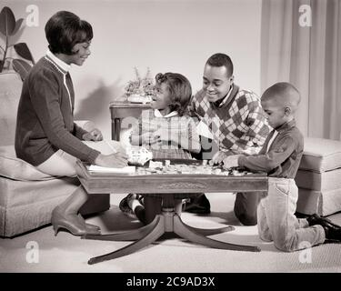 1960s AFRICAN-AMERICAN FAMILY MOTHER FATHER BOY GIRL AROUND COFFEE TABLE COUNTING MONEY FROM PIGGY BANK - n2253 HAR001 HARS MOTHERS SAVING LEARNING OLD TIME BUSY FUTURE TEACHING NOSTALGIA BROTHER OLD FASHION SISTER 1 JUVENILE STYLE COMMUNICATION YOUNG ADULT TEAMWORK COUNTING SONS FAMILIES JOY LIFESTYLE SATISFACTION FEMALES BROTHERS STUDIO SHOT HEALTHINESS HOME LIFE FINANCES COPY SPACE FRIENDSHIP HALF-LENGTH DAUGHTERS INSPIRATION CARING MALES SIBLINGS CONFIDENCE SISTERS FATHERS B&W FINANCIAL GOALS DREAMS HAPPINESS AFRICAN-AMERICANS AFRICAN-AMERICAN DADS EXCITEMENT BLACK ETHNICITY PRIDE SIBLING - Stock Photo
