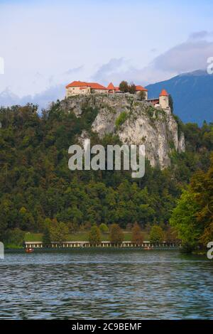 Bled Castle is a medieval castle built on a precipice above the city of Bled, overlooking Lake Bled - Stock Photo