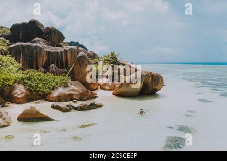 Beautiful island in the seychelles. La digue, anse d'argent beach with aerial view. Man kayaking with transparent kayak in the morning