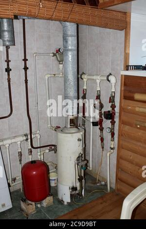 Heating system in a private house from a boiler with plastic pipes