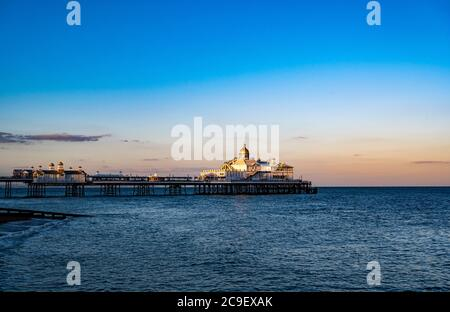 Eastbourne Pier seen from the Beach at Sunset - Stock Photo