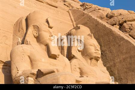 Colossal statues at the great temple of Ramesses II, Abu Simbel, Egypt - Stock Photo