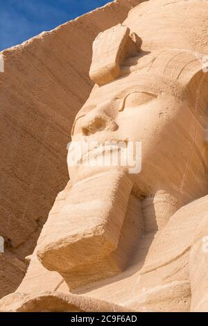 Colossal statue at the great temple of Ramesses II, Abu Simbel, Egypt - Stock Photo