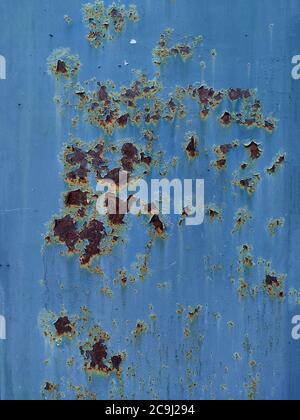 Rusty metal panel with cracked blue paint, corroded grunge metal background texture - Stock Photo