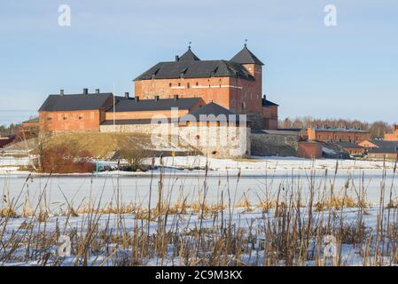 View of the ancient Hameenlinna fortress from the shore of Vanajavesi lake on a sunny March day. Finland - Stock Photo