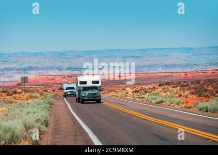 RV Camper Van on the American Road. Exploring the USA. Holiday trip vacation. Motorhome, caravan on a road. Recreational vehicle motor home trailer on