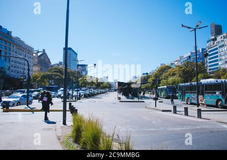 Buenos Aires, Argentina - September 4, 2018: Relatively empty bus stops and traffic jam in the main avenue of the argentinian capital. Stock Photo