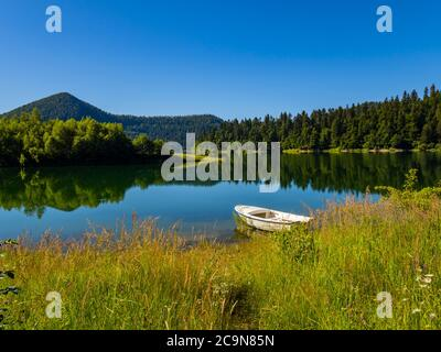 Lonely boat moored beautiful nature of Lokve lake in Croatia Europe countryside country-side - Stock Photo
