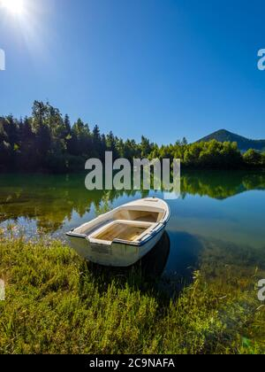 Lonely boat moored beautiful nature of Lokve lake in Croatia Europe - Stock Photo
