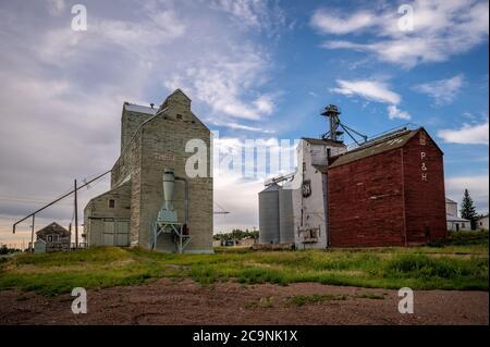 Three Hills, Alberta - July 19,2020: Abandoned grain elevators decaying in the small rural community of Three Hills. - Stock Photo