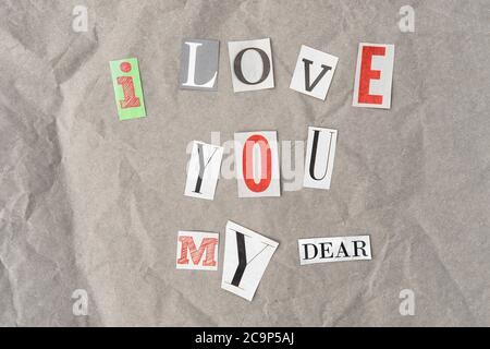 Paper cut letters. Newspaper magazine cutouts. I love you my dear
