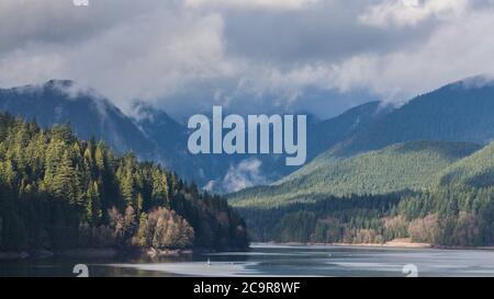 A scenic View of Cleveland Dam reservoir surrounded by mountains, North Vancouver, Canada