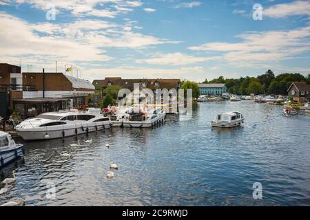 Wroxham Norfolk Broads, view of pleasure boats moored along the River Bure in the centre of Wroxham in the heart of the Norfolk Broads, England, UK - Stock Photo