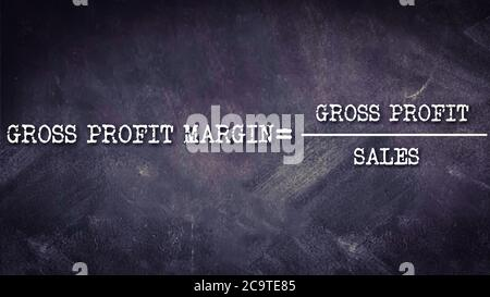 Gross profit margin equal to gross profit upon sales business equation word presented with digital text art black chalkboard pattern for learning purp - Stock Photo