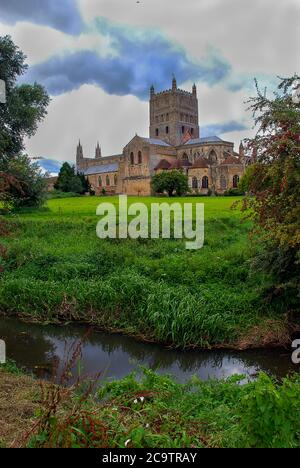 Clouds over Tewkesbury Abbey in Gloucestershire, England - Stock Photo