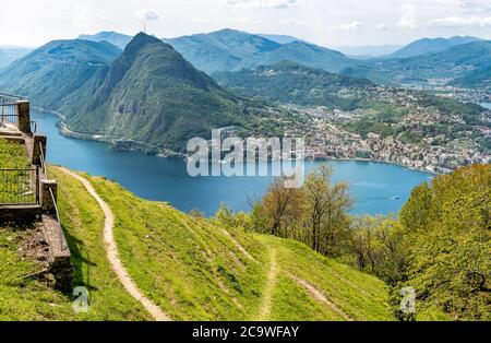 Scenic view of lake Lugano with Monte San Salvatore and Lugano town from Monte Bre,  Ticino, Switzerland - Stock Photo