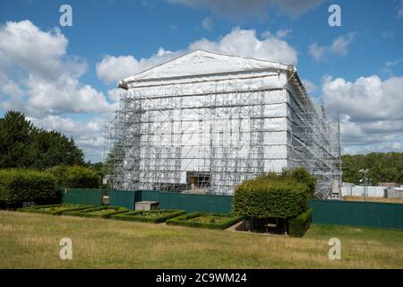 Clandon Park House, which had a major fire in 2015, covered in plastic and scaffolding, Surrey, UK - Stock Photo