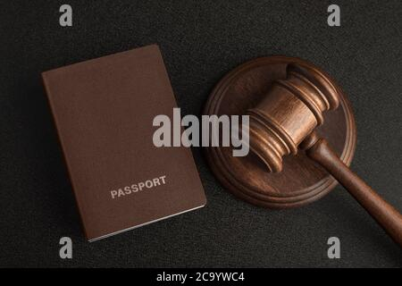 Passports and judge gavel on gray black background. Legal immigration. Obtain citizenship.