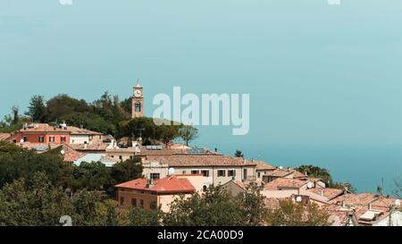 Panoramic view of 'Fiorenzuola di Focara', a small italian town in 'San Bartolo National Park' above Mediterranean sea (Pesaro, Marche, Italy, Europe) - Stock Photo