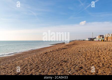 Looking along Hove seafront towards Shoreham, on a sunny winters day - Stock Photo