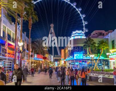 The Linq Promenade at night. Shops, bars and restaurants on The Linq Promenade looking towards the High Roller ferris wheel,  Las Vegas, Nevada, USA - Stock Photo