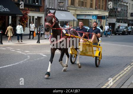 Windsor, Berkshire, UK. 3rd August, 2020. Travellers en route to the pub in Windsor with their pony and trap. Credit: Maureen McLean/Alamy Live News - Stock Photo