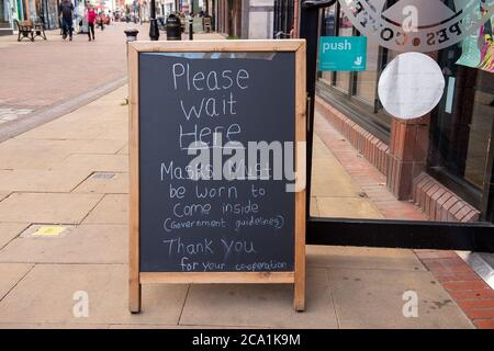 Windsor, Berkshire, UK. 3rd August, 2020. A chalk board outside an ice cream parlour in Windsor advising customers that they must wear a mask inside their shop. Credit: Maureen McLean/Alamy - Stock Photo
