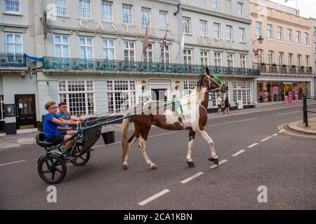 Windsor, Berkshire, UK. 3rd August, 2020. A traveller pony and trap outside the Castle Hotel in Windsor this evening. Credit: Maureen McLean/Alamy - Stock Photo