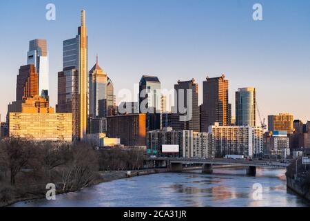 Cityscape of Philadelphia skyscraper Skylines building sunset along river in Philly city downtown of Philadelphia in PA USA. Cityscape Urban lifstyle Stock Photo