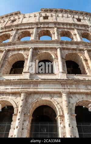 Architectural details of the facade of the Colosseum (Coliseum) or Flavian Amphitheatre, the largest Roman amphitheater located in city of Rome,