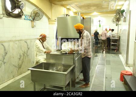Sikh Temple Gurudwara Bangla Sahib in Delhi, India - Stock Photo