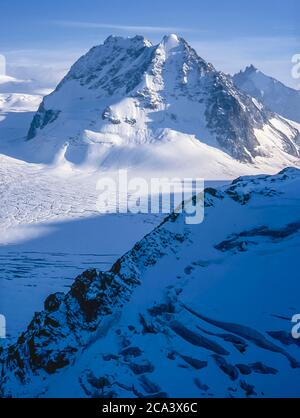 Switzerland. Arolla. These are the mountains of the Arolla Alps in Switzerland that are seen and crossed on the old hunters high mountain trade route between the French town of Chamonix and the Swiss town of Zermatt as it was in 1989. The mountains seen here  from the Vignettes Hut across the head of the Otemma glacier are on the left Mitre Peak and right L'Eveque - Stock Photo