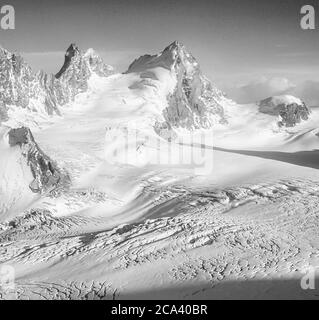 Switzerland. Arolla. These are the mountains of the Arolla Alps in Switzerland that are seen and crossed on the old hunters high mountain trade route between the French town of Chamonix and the Swiss town of Zermatt. The mountains seen here  from the Vignettes Hut across the head of the Otemma glacier are on the left Mitre Peak and on the right L'Eveque - Stock Photo