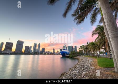 Miami, Florida city skyline on Biscayne Bay at dusk.
